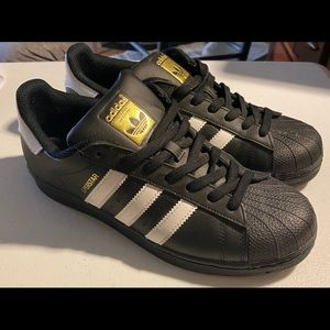 Black and gold classic adidas shoes